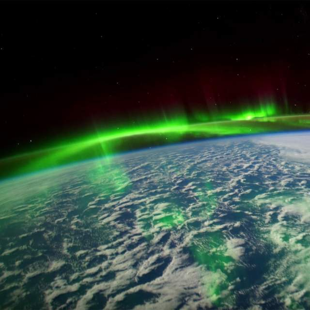 The earth with aurora borealis from space