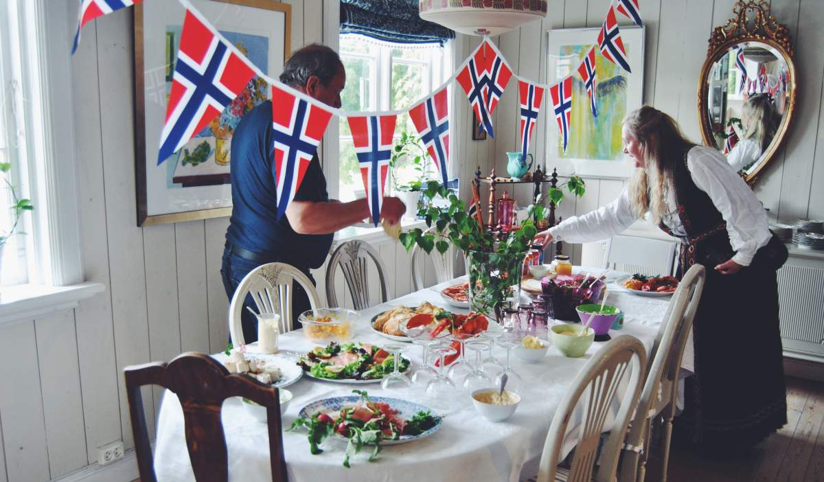 Two people getting ready for a 17 May breakfast on the Norwegian Constitution Day