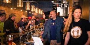 Crowd drinking at Belly Love Brewing Company's bar