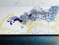 Photo of painted mural featuring ocean life including a manatee