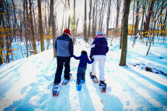 Family snowshoeing at Blandford Nature Center.