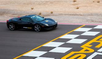 Black car crossing the finish line at Speed Vegas