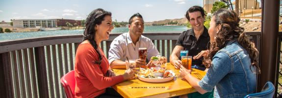 Group enjoying food and drinks on riverfront in Laughlin