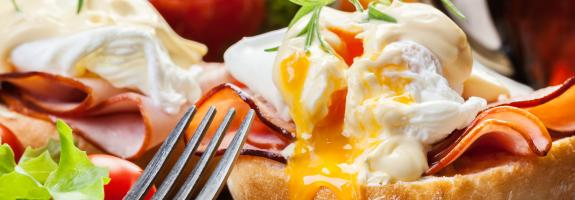 Eggs benedict with fork