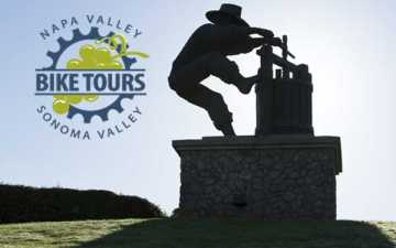Bicycles to Borrow logo with the grape crusher statue
