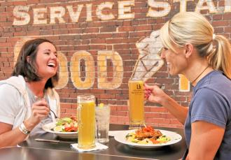 Friends laugh over a meal at Lb. Brewing Co. & Gella's Diner in Hays, KS