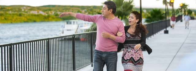couple walking along the Laughlin Riverwalk