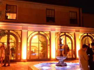 People Mingling In The Courtyard At Southern Hotel Night