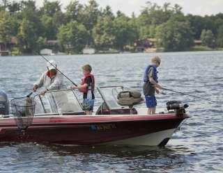 kids fishing in boat