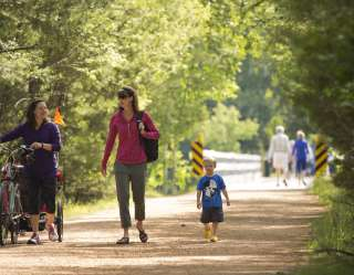 family walking on trail
