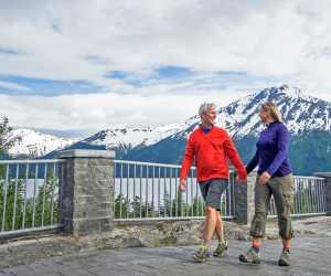 A couple walks at Bird Point along Turnagain Arm.
