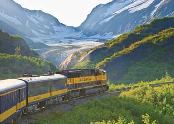 Alaska Railroad train passes a Glacier in Grandview