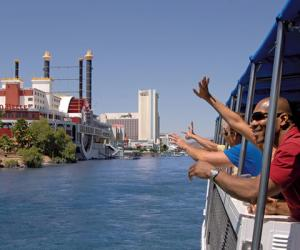 Men waving on a boat in Laughlin