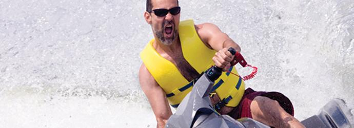 Man on a jet ski with a yellow life vest