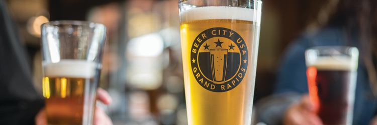 Beer City Pint Glasses at Founders Brewing Company. Center beer: Lemondrop IPA