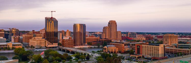 The Grand Rapids downtown skyline sparkles in sunlight in the aerial view.