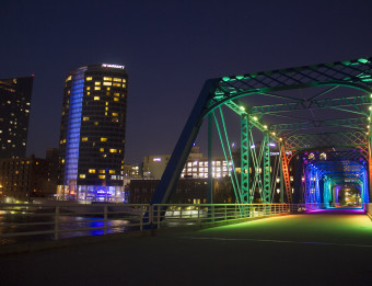 View of the Rainbow Bridge and Downtown Grand Rapids at night