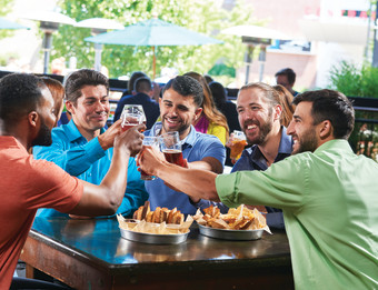 A group of men enjoying dining and craft beer at Founders Brewing Company.