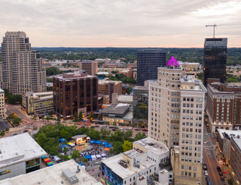 Rosa Parks Circle alive with a festival, Summer 2019. Cityscape view with the three AHC Hospitality hotels.