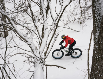 Riding a fat bike through wintry trails.