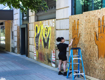 Artist Working on Window Mural - Monroe Ave
