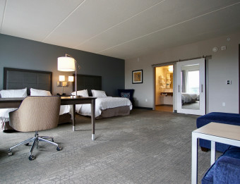 Accessible hotel room with two beds and large, open space at the Hampton Inn.