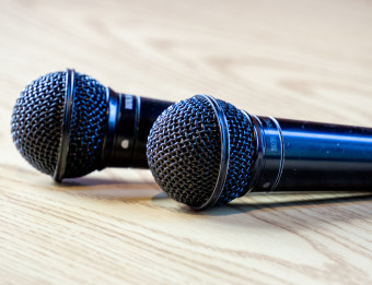 Two microphones on a wood surface
