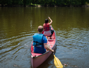 Two People Canoeing