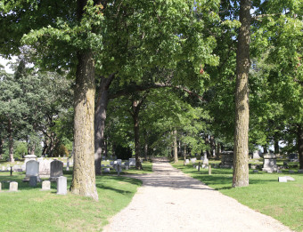 Walking path through trees in an historic cemetery in Grand Rapids