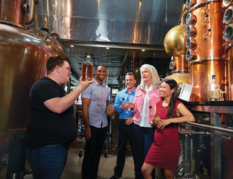 People enjoying beverages at a local distillery in Grand Rapids
