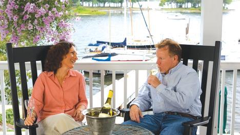 Couple drinking wine on patio