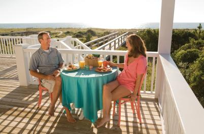 Couple Eating Breakfast on Porch