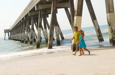 Couple Walking Under Pier