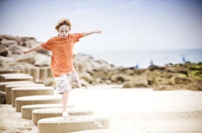 Kid Jumping From Stone to Stone