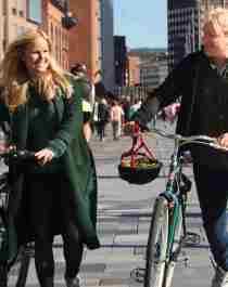 Experience Oslo by bike - two cyclists at Aker brygge in Oslo, Eastern Norway