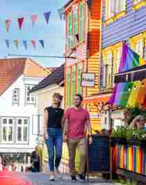 A couple walking in Fargegaten (the street of color)