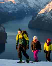 A family of three snowshoeing at Aurlandsfjellet