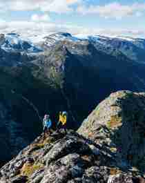 Two people hiking Mount Kattanakken in Jostedalsbreen national park, Fjord Norway