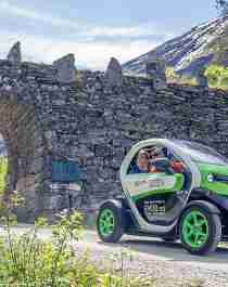 A couple exploring Norway the green way with an eMobility electric car