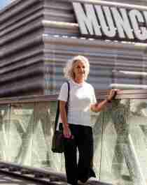 A woman walks past the MUNCH museum