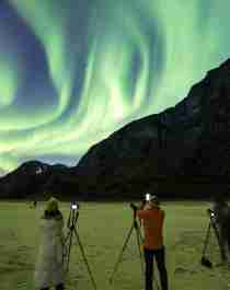 People learning how to photograph the northern lights in Gildeskål, Northern Norway