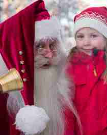 Santa Claus and a girl at one of Norway's top Christmas destinations, Savalen