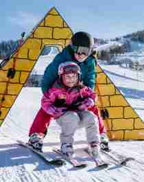 A child learning to alpine ski in Vestlia at Geilo, Eastern Norway