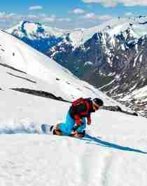 A guy snowboarding in Stryn