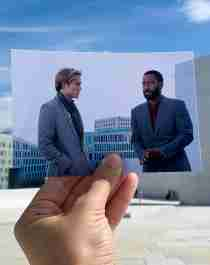 A printed-out film still of the movie Tenet aligned with the real-life location on the roof of the Norwegian Opera House in Oslo, Eastern Norway