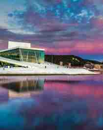The Oslo Opera building under a pink sky