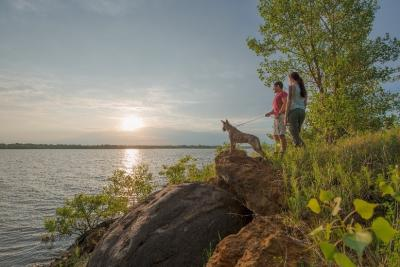 Couple with dog overlooking the lake at Kanopolis State Park