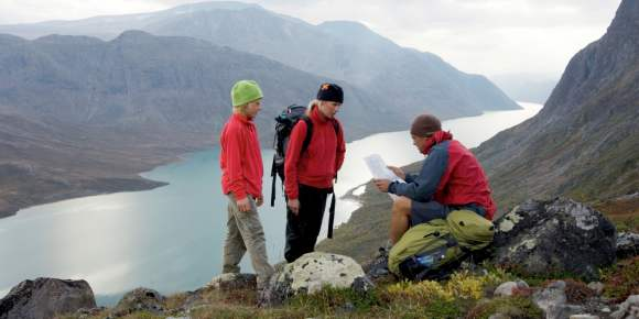 06f28b5b540e2 A family reading a map in the Jotunheimen mountains