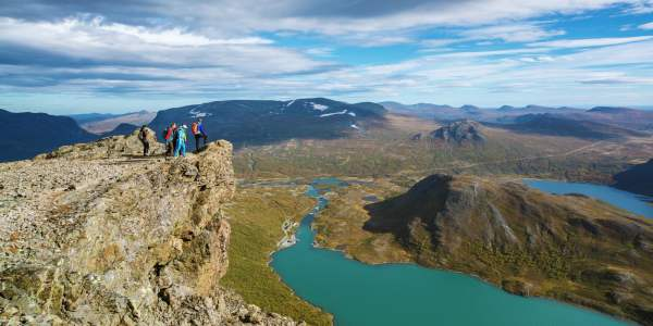A group of people standing on the top of the Besseggen ridge in Jotunheimen