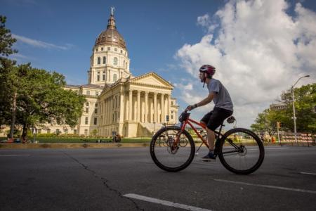 Copy of Guy on Bike in front of Capitol